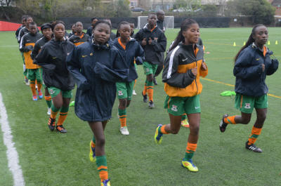 The Zambia womens u-17 national soccer team runs laps at practice on Monday, Mar. 3, 2014, in San Rafael, Calif. Geoffrey Levy is helping the girls, age 14-17, achieve a spot in the World Cup games. (Frankie Frost/Marin Independent Journal) Frankie Frost