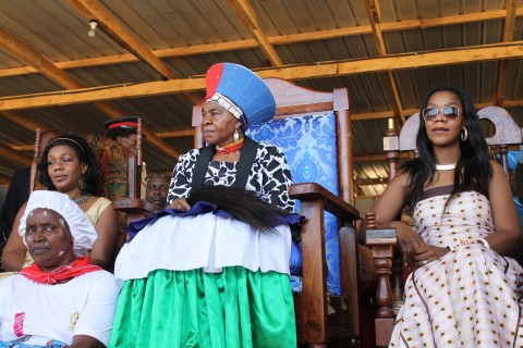 The cheiftainess with her daughters in the grand stand - Photo by Andrew Mulenga