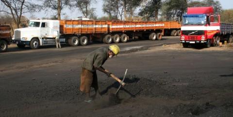Trucks transporting coal at Collum Coal Mine in Southern Province. Image by Eddie Mwanaleza. Zambia, 2013.