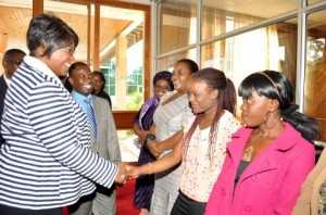UNZA student Tilolele Mwanza greets First Lady Dr Christine Kaseba Sata when she arrived at Mulungushi International Conference Centre for the First Lady's Youth Mentorship Programme