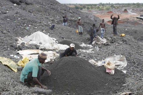 Youths scavenging the remains of the metals in the abandoned ZCCM black mountain in Kitwe - picture Thepost