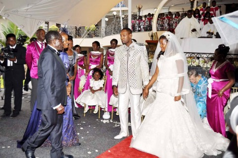 Zimbabwean President Robert Mugabe and First Lady Grace Mugabe during the wedding ceremony of their daughter Bona Mugabe and her husband Simba at their residence in Harare, Zimbabwe on March 1,2014
