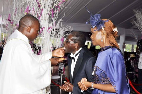 Zimbabwean President Robert Mugabe and First Lady Grace Mugabe with Fr Kennedy Muguti during the wedding ceremony of their daughter Bona Mugabe and her husband Simba at their residence in Harare