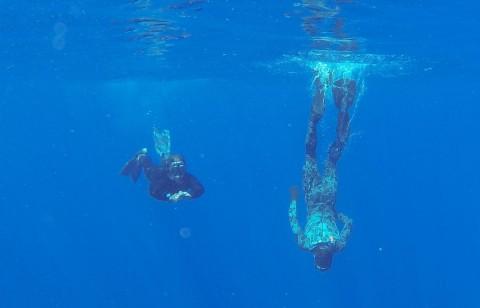 Able Seaman Clearance Divers Matthew Johnston, right, and Michael Arnold from the Australian Defence Vessel Ocean Shield scan the water for debris in the southern Indian Ocean.