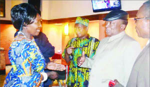 CHIEF Chibesakunda (in black cap) stressing a point as Gender and Child Development Minister Inonge Wina (left), Chief Mporokoso (in traditional attire), and House of Chiefs clerk Michael Pwete (right) listen. This was after the minister officiated at a consultative meeting with traditional leaders in Lusaka yesterday. Picture by CHUSA SICHONE.