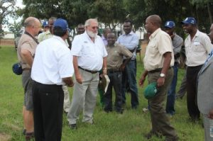 Commissioner of Prisons Percy K Chato listens to Saro Agro Equipment Technical Officer at the Saro Farms Field Day in Lusaka West.