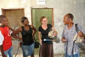 Elsye Callahan, second from right, learns about indoor residual spray, a preventative measure to keep people from getting malaria in November 2012.