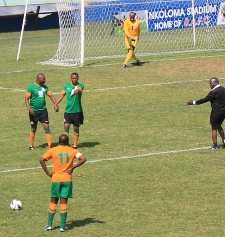 Familiar posture! Kalu stands with hands akimbo as he prepares to take a free-kick