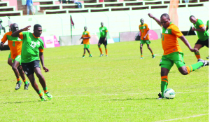 Kalusha Bwalya (right) shoots goalwards as his former Chipolopolo team mate, Elijah Tana closes in during the KK11 versus 1994/1996 squad match at Nkoloma Stadium in Lusaka