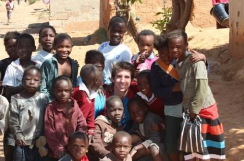 Lonnie Hackett '14 with school children in Zambia