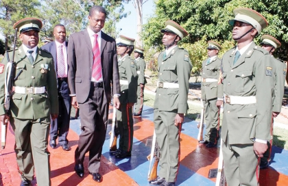 MINISTER of Defence Edgar Lungu (right) inspects a guard of honour on arrival at one engineering regiment barrack in Mufulira on Thursday. – Picture by NKOMBO KACHEMBA.