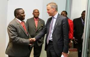 Minister of foreign affairs Mr Harry Kalaba greets British Parliamentary Under Secretary of State Mr Mark Simmonds shortly before their meeting in Brussels, Belgium on Thursday, 03-04-2014. Picture by EDDIE MWANALEZA