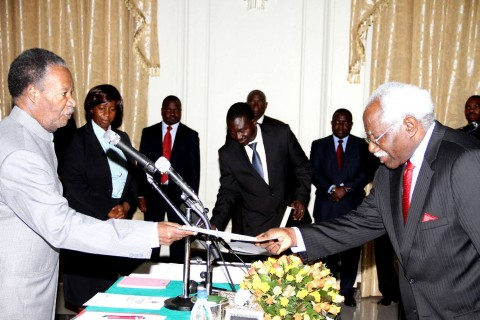 President Sata receives an affidavit of oath from newly sworn-in-State Counsel Mumba Kapumpa during the Swearing in Ceremony at State House on April 25,2014