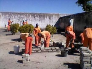Prisoners practicing brick laying and plastering in Maximum Security Prison