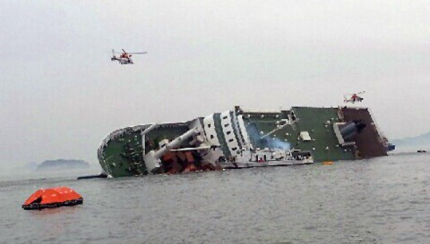 South Korean rescue helicopters fly over a South Korean passenger ship, trying to rescue passengers from the ship in water off the southern coast in South Korea, Wednesday, April 16, 2014