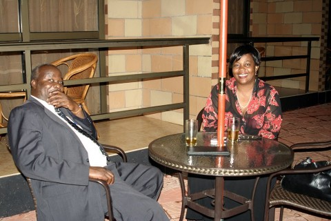 Lameck Mangani having a drink with former Lands Minister Judith kapijimpanga - Photo Credit - thepicturemonger