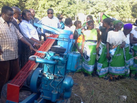 Mr. Yaluma handing over the donated Hammer mill to a women club in Malole Constituecny