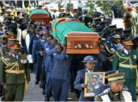 PALLBEARERS arrive with the caskets for the late Zambia Air Force Deputy Commander Major General Muliokela Muliokela and Commanding Officer Colonel Brian Mweene at the Cathedral of the Holy Cross in Lusaka yesterday. Pictures by STEPHEN KAPAMBWE