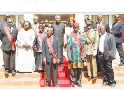 PRESIDENT Sata (centre back row) and acting Chief Justice Lombe Chibesakunda (second from left second row) pose honorees after the investiture ceremony at State House yesterday. – Picture by MACKSON WASAMUNU.