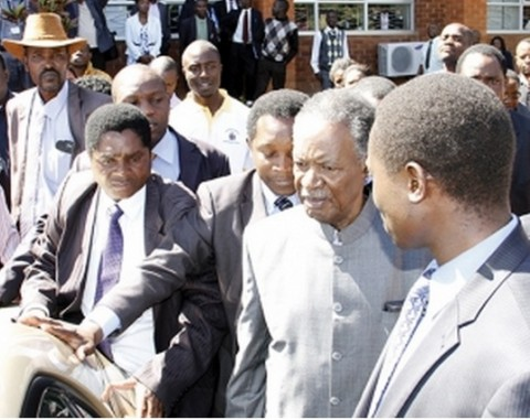 PRESIDENT Sata (second from right) leaving the High Court in Lusaka yesterday. – Picture by MACKSON WASAMUNU.