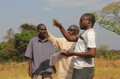 Paul Shalala (right) speaking with farmers as part of his investigation into the impact of mining on local residents