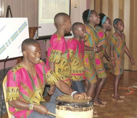 Performing various songs they've learned in class, Eustis, left, Eric, Frederick, Bertha, Dinas and Vivian, school children from Kitwe, Zambia, enjoy showcasing what they've learned.