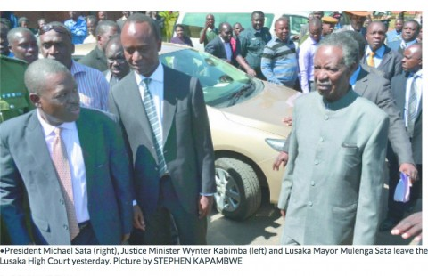 President Michael Sata (right), Justice Minister Wynter Kabimba (left) and Lusaka Mayor Mulenga Sata leave the Lusaka High Court yesterday. Picture by STEPHEN KAPAMBWE