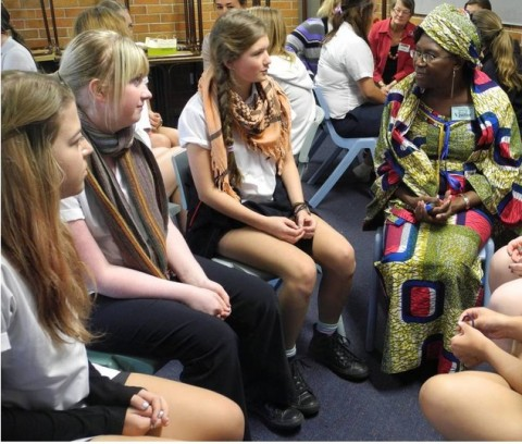 Wingham High year 10 students Abbie James, Taylah Zanardi, Grace Callaghan, Rachel Atkins and Brianna Xuereb with Dorothy Makasa.