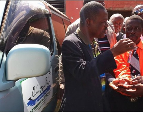 Wynter M. Kabimba  hands over two minibuses donated to the PF in Northern Province to enhance their mobilisation work.