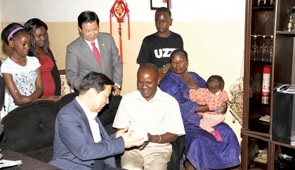 CHINESE Vice-President Li Yuanchao (left) presenting a gift to January Mkandawire when he visited him at his house in David Kaunda Technical School Teachers' compound in Lusaka.