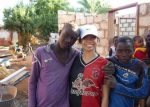 Christine Gamboa, center, with children in Kamunga, a village in Zambia where SFU residence students built houses for orphaned and vulnerable children and their caregivers