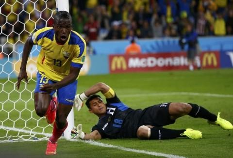Ecuador's Enner Valencia celebrates after scoring a goal past goalkeeper Noel Valladares of Honduras during their 2014 World Cup Group E match