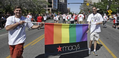 In this June 8, 2014, photo, workers carry a Macy's banner during the gay pride parade, in Salt Lake City. (AP Photo:Rick Bowmer)