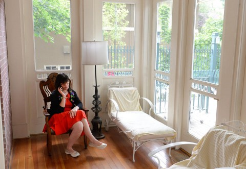 Kate Kelly, founder of Ordain Women, checks messages of support and requests for interviews during a quiet moment at a bed and breakfast near the Church of Jesus Christ of Latter-day Saints in Salt Lake City