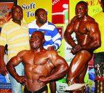 Mr Zambia Moses Mwape (r) and reigning Mr Matero Nduba Shanabwato (foreground), who came second in this year's Mr Zambia, posing for a photo at Pamodzi hotel