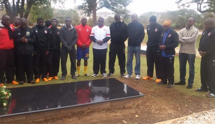 NKANA players and officials at the grave of legendary commentator Dennis Liwewe at Lusaka Memorial Park yesterday. - Picture by DIANA MUTAKAFIMBO.