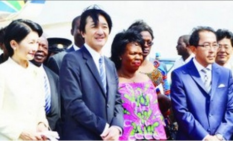Prince Akishino (2nd L) and Princess Kiko (1st L) watch Zambian traditional dancers shortly after arriving at Kenneth Kaunda International Airport in Lusaka, Zambia, on June 28, 2014.