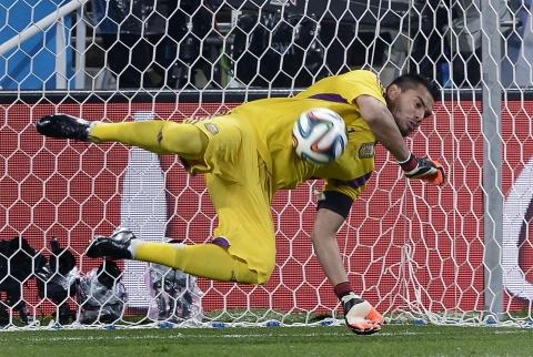 Argentina's goalkeeper Sergio Romero saves a penalty
