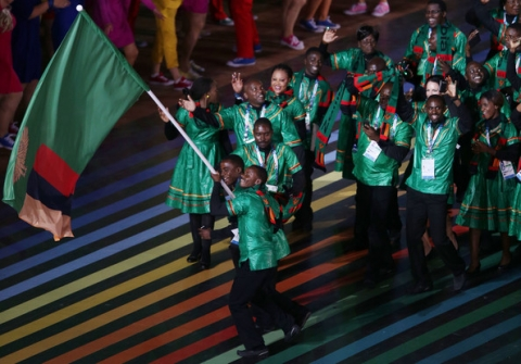 Flag bearer and judoka Punza Mathews of Zambia during the Opening Ceremony for the Glasgow 2014 Commonwealth Games at Celtic Park on July 23