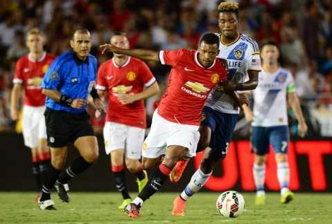 Manchester United's Nani vies for the ball with Michael Keane of the LA Galaxyduring their match in Pasadena, California, on July 23, 2014 (AFP Photo/Frederic J Brown)