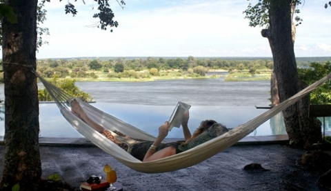Relaxing whilst reading a good book at The River Club (Dana Allen)
