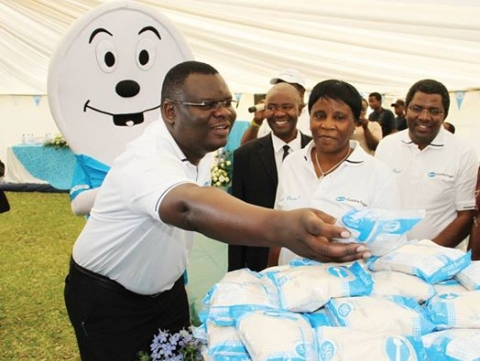 FROM left: Commerce Trade and Industry director Mateo Kaluba, Zambia Sugar Rabecca Katowa and company managing director Aubrey Chibumba during the launch of a new 500-gramme pack at Nakambala Estates in Mazabuka recently. - Picture by MACKSON WASAMUNU.