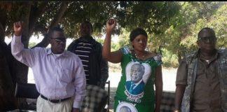 Secretary General Wynter Kabimba, Zambezi West PF candidate Christabel Ngimbu and her campaign manager Wilbur Simuusa sing the national anthem at a meeting