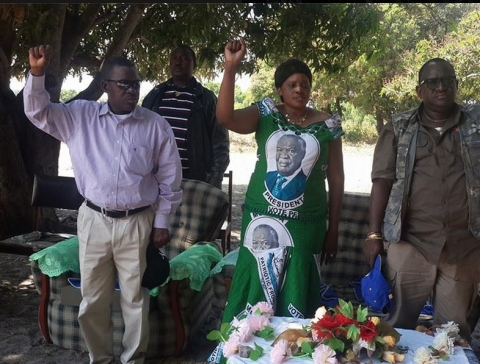 Secretary General Wynter Kabimba, Zambezi West PF candidate Christabel Ngimbu and her campaign manager Wilbur Simuusa sing the national anthem at a meeting