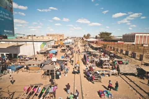 An outdoor market in Lusaka. Visitors can find all kinds of wares in the city's numerous markets, including second-hand clothes. iStockphoto.com