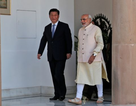 Indian Prime Minister Narendra Modi and visiting Chinese President Xi Jinping walk for a meeting in New Delhi, India, Thursday, Sept. 18, 2014. Manish Swarup—AP