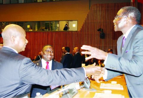 PRESIDENTS Robert Mugabe of Zimbabwe (right) and Yoweri Museveni of Uganda, share a light moment with Zambia's Foreign Affairs Minister Harry Kalaba (centre) at UN Headquarters in New York on Monday. Picture by CHIBAULA SILWAMBA