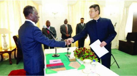 President Michael Sata shakes hands with new Chinese Ambassador to Zambia Youming Yang. This was after the Ambassador presented his credentials at State House.