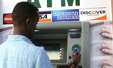 A Somali man uses the first-ever cash machine in Mogadishu. Photograph: Abdulfitah Hashi Nor/AFP/Getty Images