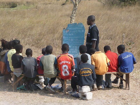 A class meets under a tree in Mwalubemba village, Zambia as the new school is built